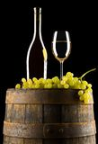 Wine and grapes on barrel Stock Image