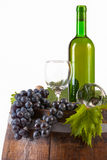Wine and grapes on barrel Royalty Free Stock Photos