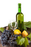 Wine and grapes on barrel Royalty Free Stock Images