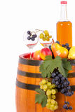 Wine and grapes on barrel Royalty Free Stock Image