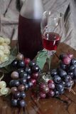 Wine and grapes. Bottle of wine surrounded by grapes and a glass of wine ready to enjoy with that special someone in your life Royalty Free Stock Photos
