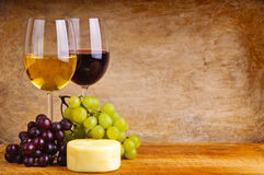 Wine, grapes and cheese stock images