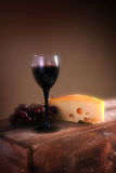 Wine grapes and cheese Stock Image