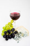 Wine grapes and cheese Royalty Free Stock Photos