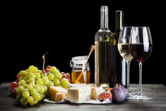 Wine, grapes and cheese. Assortment Stock Photography