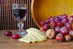 Wine, grapes and cheese on a board Royalty Free Stock Photo