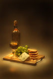 Wine, grapes, cheese and bread. In the night Stock Photography