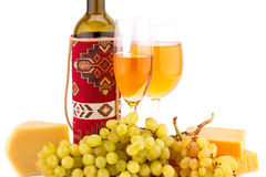 Wine, grapes and cheese. Isolated on white background Royalty Free Stock Photo