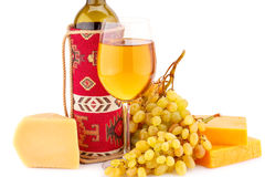 Wine, grapes and cheese. Isolated on white background Royalty Free Stock Image