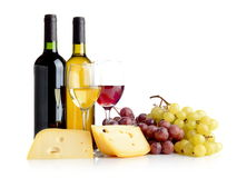 Wine, grapes, cheese isolated on white. Wine in bottles and glasses, grapes, cheese isolated on white Stock Images