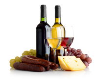 Wine, grapes, cheese an sausage isolated on white. Wine in bottles and glasses, grapes, cheese an sausage isolated on white Stock Photo