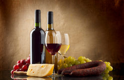 Wine, grapes, cheese an sausage on linen background. Wine in bottles and glasses, grapes, cheese an sausage on linen background Stock Photos