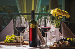 Wine and grapes and cheese on the table. In a restaurant Stock Photo