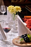 Wine and grapes and cheese on the table Stock Images