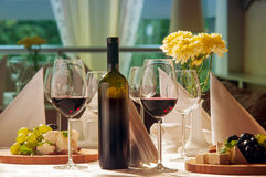 Wine and grapes and cheese on the table. In a restaurant Royalty Free Stock Image