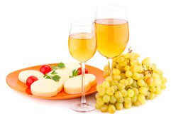 Wine, grapes and cheese. Wine, grapes, cheese and tomatoes isolated on white background Royalty Free Stock Photo