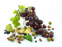 Wine, grapes and food on white background stock photo