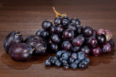 Wine grapes and fruits Stock Photo