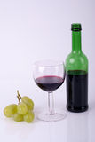 Wine and grapes. Wine in a glass, a bottle of wine and grapes Stock Photo
