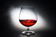 Wine grapes in a glass. Wine made from red grapes Stock Photography