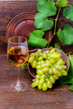 Wine and grapes. Glass of white wine with grapes Stock Photo