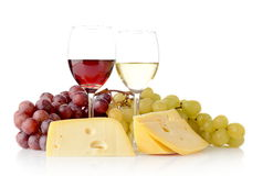 Wine and grapes isolated on white with cheese. Red and white wine in wineglasses, two bunches of grapes and cheese isolated on white Royalty Free Stock Photo