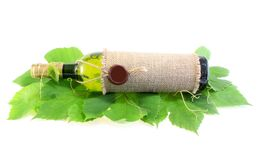 Wine on grapes leaves Stock Photography