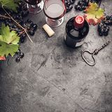 Wine composition on dark rustic background Royalty Free Stock Photos