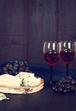 Wine, grapes, nuts, cheese, blue cheese. Dinner, lunch, romantic date, picnic. Royalty Free Stock Photos