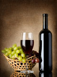 Wine and grapes on a old background Stock Image