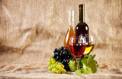 Wine and grapes on vintage background Royalty Free Stock Photography