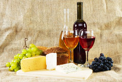 Wine and grapes on vintage background Stock Photos