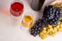Wine and grapes. White and red wine in glasses and bottle of win Stock Photos
