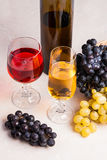 Wine and grapes. White and red wine in glasses and bottle of win Royalty Free Stock Photo