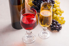 Wine and grapes. White and red wine in glasses and bottle of win Stock Photography
