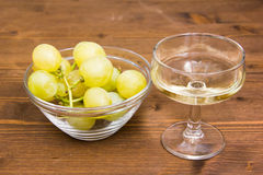 Wine and grapes on wood Stock Photography