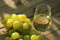 Wine and grapes on wooden table Royalty Free Stock Photo