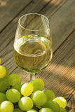Wine and grapes on wooden table Royalty Free Stock Photography