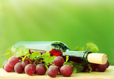 Wine on green background Stock Photo
