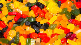 Wine gums or fruit gums background texture. Of sugary chewy candy made with gelatin in a variety of shapes and vibrant colors Royalty Free Stock Images