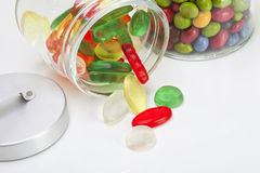 Wine gums and Smarties in candy jar, close up Stock Photos