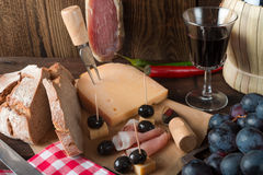 Wine - ham - bread, a tasty one eats Stock Photography