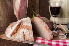 Wine - ham - bread, a tasty one eats Stock Photos