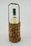 Wine holder. A hancrafted, decorative wine holder with a bottle of white wine Stock Photo