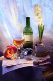 Wine and hyacinths Stock Image