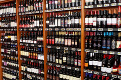 Wine italian store. Shelves with bottles in a wine shop in Rome (Italy Stock Photos