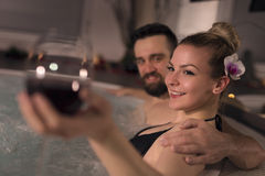Wine in a jacuzzi Stock Photography