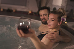 Wine in jacuzzi Stock Images