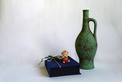Wine jug and blue gift box on white. Stock Photo