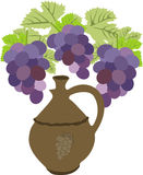 Wine jug with  grape Stock Images